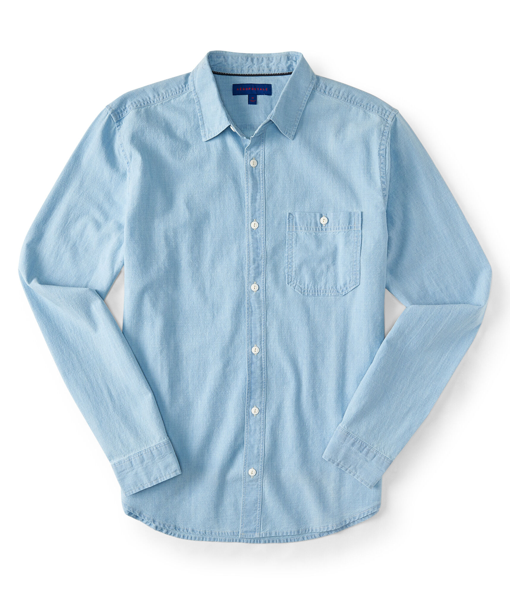 Chambray Shirt: fabric & care % Cotton. Machine wash. Imported. overview Chambray denim. Light indigo wash. Long sleeves with button cuffs. Collar, button front. Button-flap patch pockets at chest, slant pockets at front. Button-tabs at back. The water used in the.